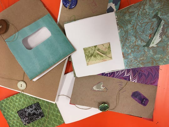 """Stitch a book with twine or other string. First, use an awl to make a """"signature."""""""