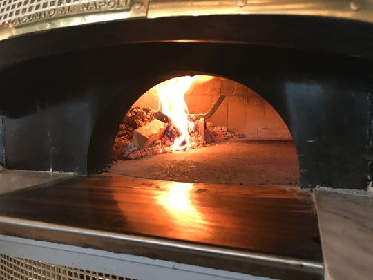 MidiCi Pizza uses a pair of wood-fired brick ovens. The pizzas cook in about 90 seconds.