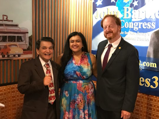 John Bartlett, right, with wife Khyati Joshi and supporter Dr. Bhupen Kapadia, declares his intent to unseat Rep. Rodney Frelinghuysen in the 2018 race for Congress in the 11th District, at the Alps Diner in Wayne, on July 7, 2017.