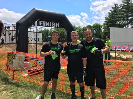 The Swampfoot 4 Mile event was Saturday in St. Clair. George and Chandler Nestell pose with Rob Flynn after finishing the course.