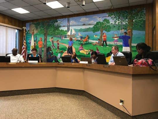 The Poughkeepsie City School District board holds its