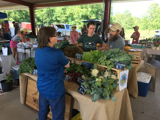 The Ashland City Farmers and Artisans Market opened for business Saturday, July 8 at Riverbluff Park in Ashland City. Kids enjoyed a jump house while families shopped the market of fresh produce, soaps, crafts, bakery and more.
