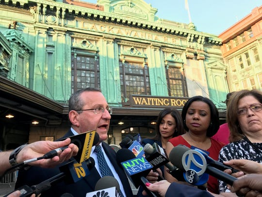 """NJ Transit spokesman Charles Ingoglia talks to reporters on Monday in Hoboken. """"We're pleased with what we've seen,"""" he said Monday morning."""