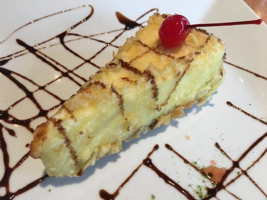 The cheesecake on Komoon's dessert menu is fried and served with a chocolate drizzle.