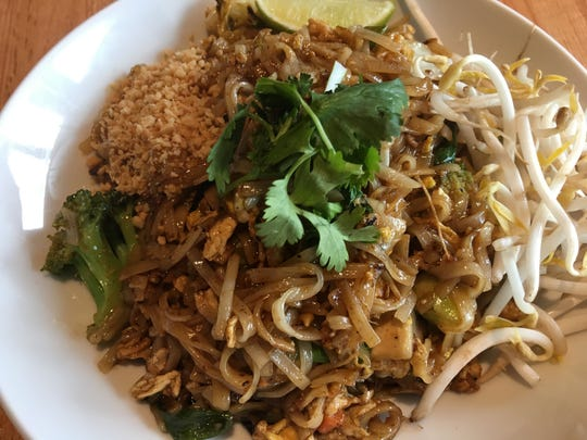 The pad thai was served with a peanut-based sauce tossed with noodles, an assortment of vegetables and bits of scrambled egg.