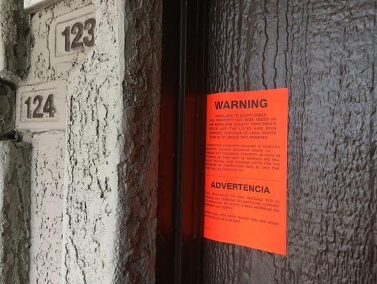 An eviction notice hangs on the front door of a Phoenix