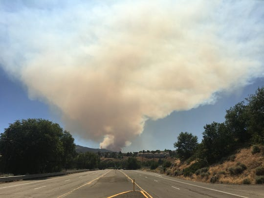 The Farad Fire is seen Monday, July 10, 2017 from Fourth Street in Reno. The fire was burning west of Verdi.