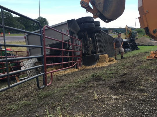 A semi-tractor trailer hauling cattle overturned Tuesday morning, closing the northbound exit ramp on I-69 at Ind. 332.