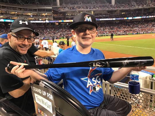 Rob and Nick Castagna. 13-year-old Nick traded the ball Zack Cozart hit for his first All-Star hit for two autographed Joey Votto baseballs and an autographed bat.