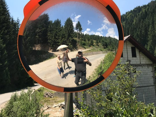Writer Bruce Dorries checks out country roads in Romania