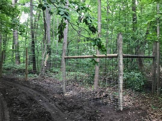 An 8-foot-high fence under construction at Flat Rock Brook Nature Center along Jones Road in Englewood. The fence is intended to keep deer out of the reserve and protect native underbrush. A 55-acre parcel will be left open to  the deer.