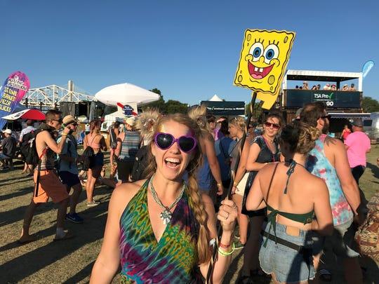 Colleen Kelly holds up her Spongebob Squarepants totem at Forecastle 2017. July 15, 2017