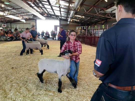 Lyla Sprague, 9, of Genoa places third with her lamb