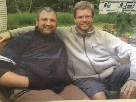 Andrew Potgieter, right, is seen with his fiance Mark