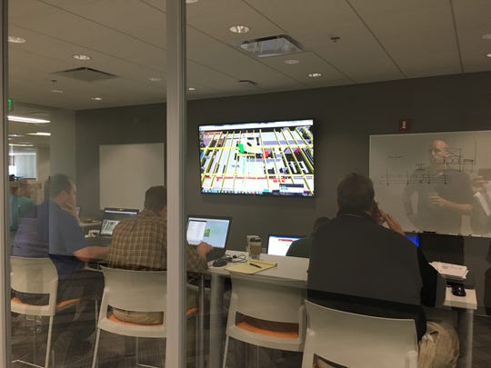 Engineers and designers work on a virtual project layout from Tweet/Garot's new headquarters in downtown De Pere.