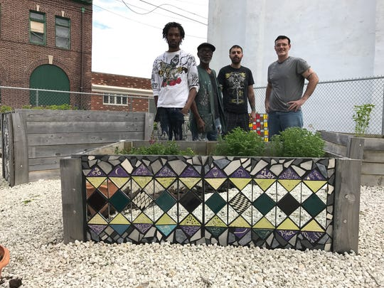Creative Vision Factory artists Charles LLoyd, Michael Solomon, Tim Austin and Silas Harrison were among those admiring the finished work at the Duffy's garden.