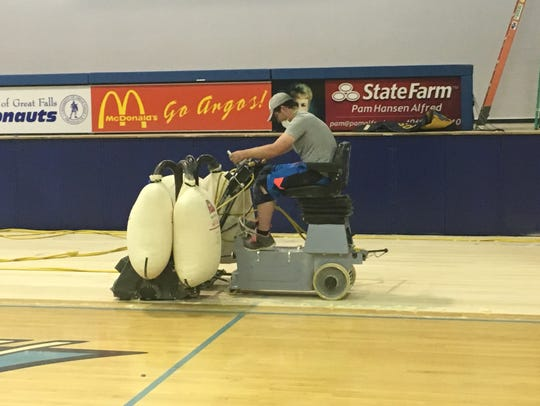 Lalum's crew works on the new court at the University