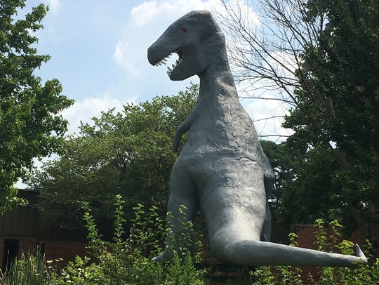 Two-story tall T. rex at Sutton Elementary School awaits
