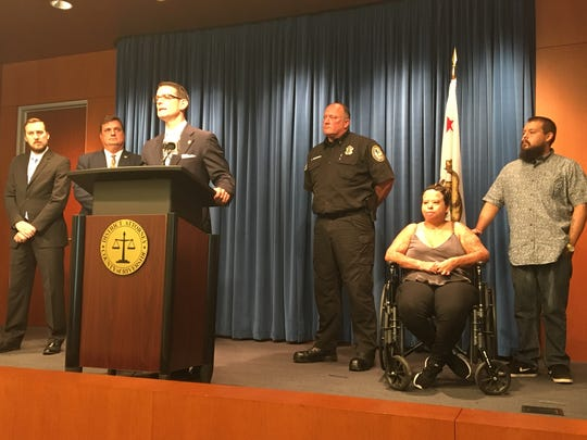 Riverside County District Attorney Mike Hestrin speaks Tuesday during a news conference denouncing honey oil manufacturing. He was joined by a couple injured in a manufacturing explosion in Palm Springs in 2015.
