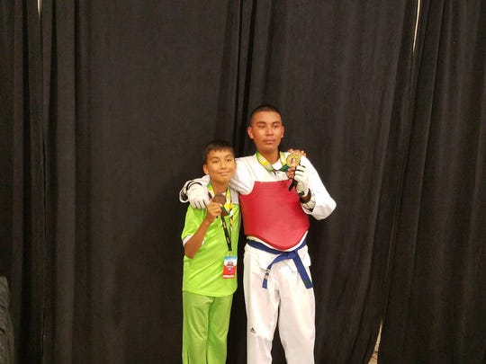 Eric Arvizu, left, and brother Paul Arvizu medaled at the AAU Taekwondo National Championships in Florida earlier this month.