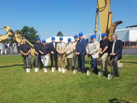 Bongards', city and county officials pose at the groundbreaking ceremony for Bongards' Creameries expansion project on July 18, 2017 in Humboldt, Tenn.