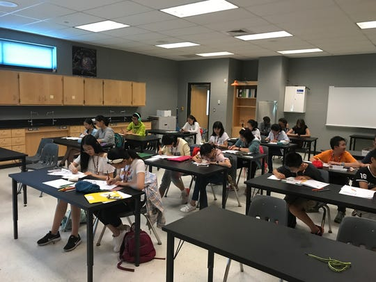 Students work on activities during the Chinese Exchange