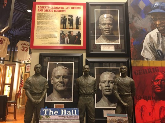 These model-scale statues of Lou Gehrig, Jackie Robinson and Roberto Clemente stand in the Character and Courage section of the Green Diamond Gallery in Montgomery, Ohio, and their full-size counterparts stand in the lobby of the National Baseball Hall of Fame after being commissioned by the Green Diamond Gallery's owner, Bob Crotty.
