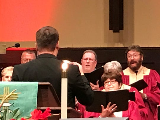 Lance Dumas directs the choir during a special service at Lea Joyner UMC.