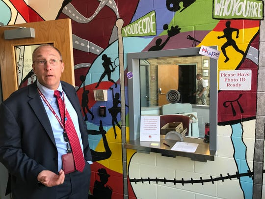 Richard Oppegaard, director of security at Matawan-Aberdeen Regional School District, shows the high school's secure entry way.