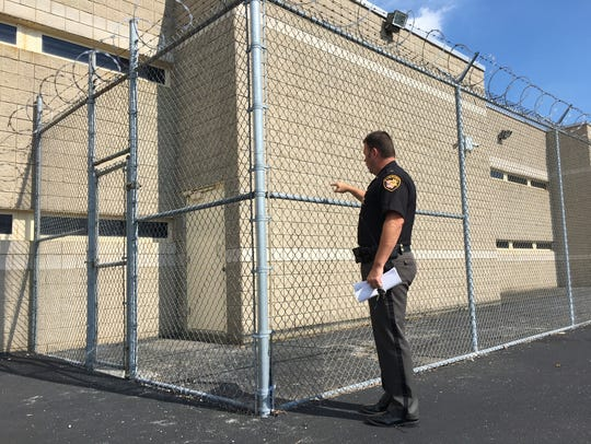Sheriff Chris Hilton points to the door at the Sandusky