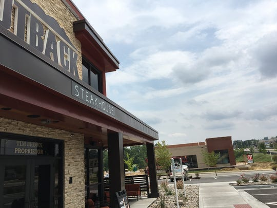 Outback Steakhouse opened May 3 in Florence Heights off Mall Road. In the background, Chick-fil-A is scheduled to open Aug. 31.