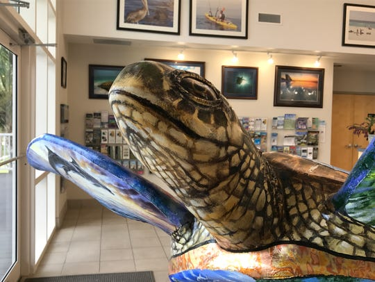 An upclose look at the face on a sea turtle statue