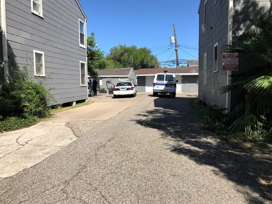 Police investigate the scene of a shooting in the 1400 block of Devon Drive on Thursday, July 21, 2017.