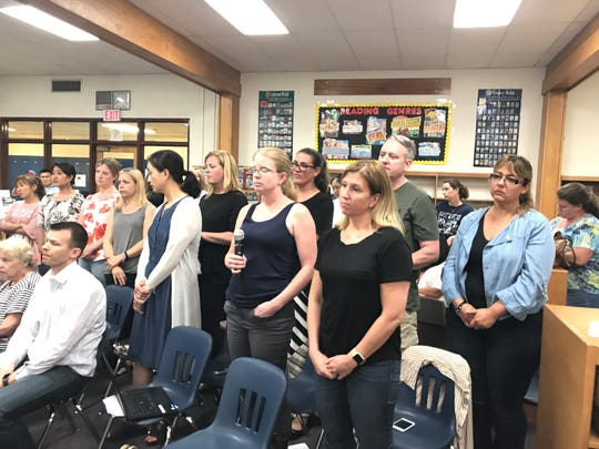 Norwood parents stand up at the June 19 Board of Education meeting to discuss  class sizes issues. The concerns about an extra section of third grade for the 2017-18 school year are expected to be addressed tonight.