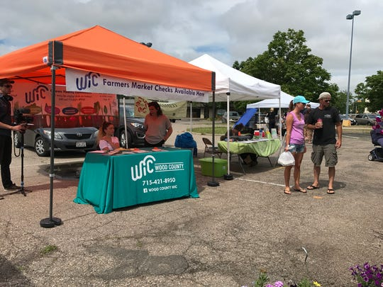 Wood County WIC set up a stand at the Wood County Farmers Market July 20, 2017 to answer any questions from residents about the market.