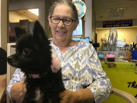 Pat Hardy, Patti Adams's mother, holds Summer, a Pomeranian