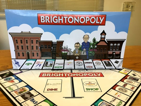 The Brightonopoly box features caricatures of Matt Modrack, the city's Downtown Development Authority and Community Development director, who died in August 2016, along with Brighton businessman Bernie Corrigan, who died in January 2017.