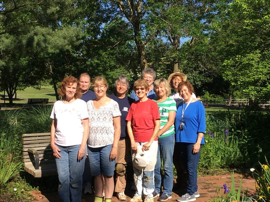 """NGC members at the Anne Van Middlesworth Sensory Garden shown from left to right are: Marion Nation,  Barbara Majewski, Pamela Siana, Cathy Heuschel, Anne Gribbon, Barbara Zielsdorff, Janet Gibson, Diana Reinhardt, and Teri Halvorson. These members have worked tirelessly to keep the gardens looking their best for the enjoyment of the community. They received the East Orange Trophy for developing, maintaining and working with a community park, garden or arboretum for """"creating a handicap accessible brick walkway at Ann Van Middlesworth Park."""""""