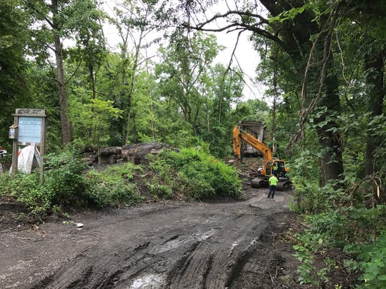 Town of New Paltz workers demolish a section of bridge along the Wallkill Valley Rail Trail at Springtown Road in New Paltz on Tuesday, July 25, 2017.