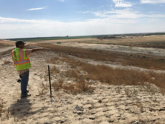 Mike Betzinger, Visalia landfill site supervisor, points  to the location where an expansion will be built. The Visalia site receives up to 1,100 tons of trash a day.