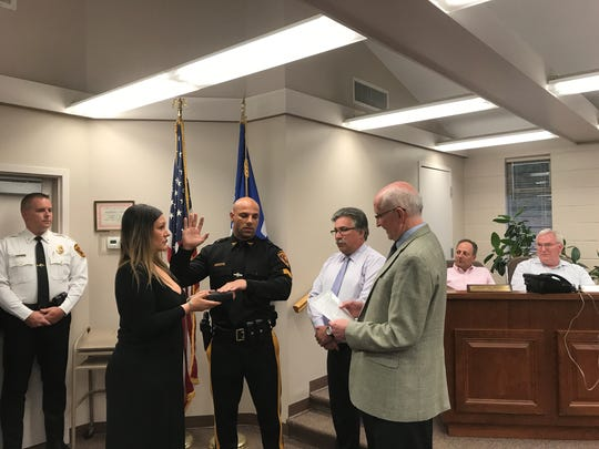 Gianluca Ragone is sworn-in as Haworth police sergeant From left to right, Chief Michael Gracey,  sister-in-law Diana Ragone holds the bible, Ragone, council member Andrew Rosenberg and Mayor John Smart at the Tuesday council meeting.