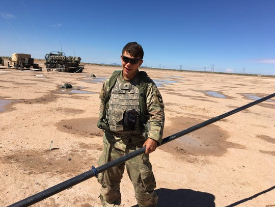 Spc. Michael Edwards, with the headquarters from 2nd Brigade, 101st Airborne Division (Air Assault), works to put up an antenna during the NIE. Last July, this Fort Campbell, Ky., brigade served as the test unit at Fort Bliss.