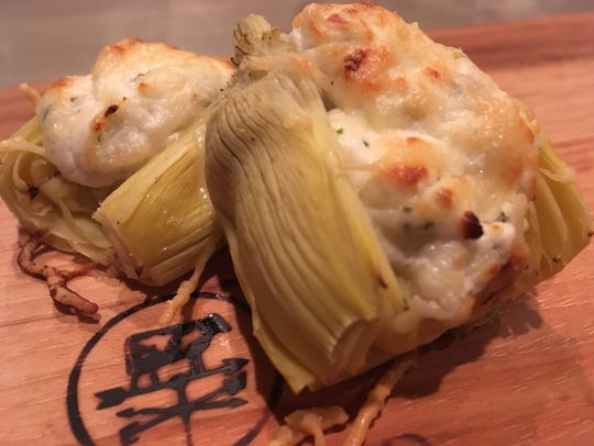 Artichoke hearts stuffed with goat cheese and herbs