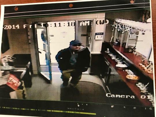 A still of surveillance video from Hebron Savings Bank