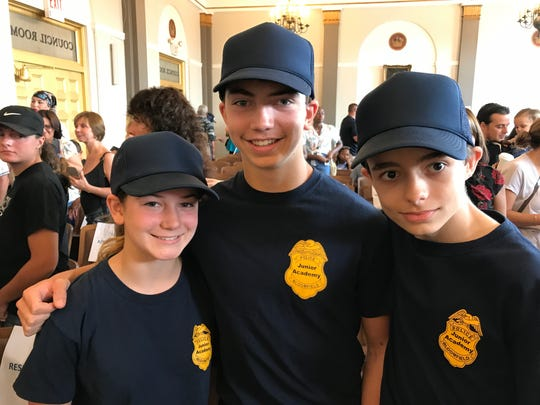 From left, Aniela Soja, Alexander Soja, and Patrick Lamport celebrate their special honors on July 28, 2017, during the Bloomfield Junior Police Academy's graduation ceremony in the Municipal Building.