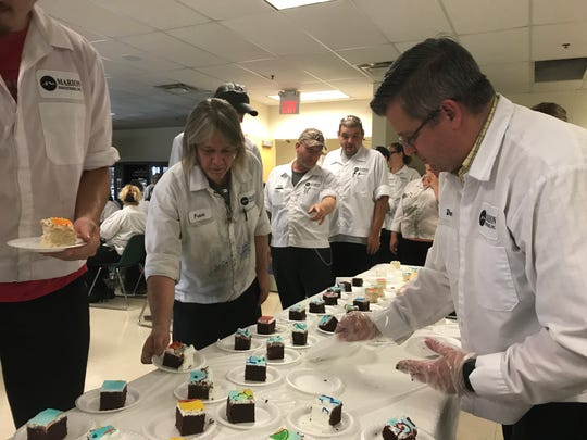 Employees at Marion Industries celebrated with cake Thursday after an awards ceremony.