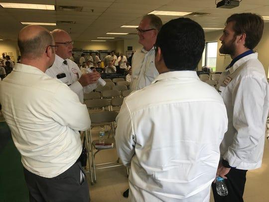 Representatives from Honda's Marysville plant speak with EGI owner Larry Jutte Thursday.