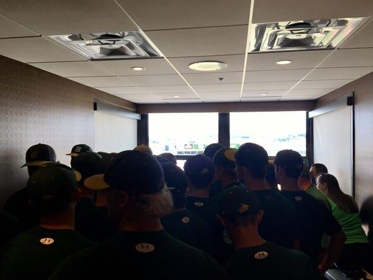 The Dyersville Beckman baseball team files into a suite