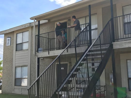 Abilene police detectives canvas the Summer Wind Apartment Homes, where a fatal shooting occurred around midnight July 29, 2017.