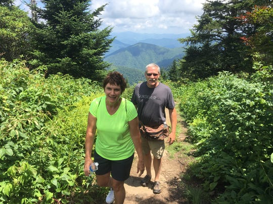 "Teresa and Kayedon O'Neal of Pennsylvania take a hike at Waterrock Knob recently. ""It's so beautiful here. We're sorry we can't be here for the solar eclipse,"" Teresa said."